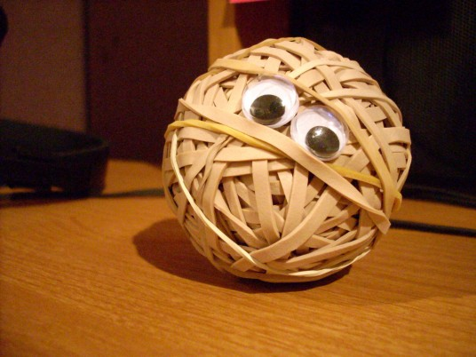 a rubber band ball with googly eyes on it