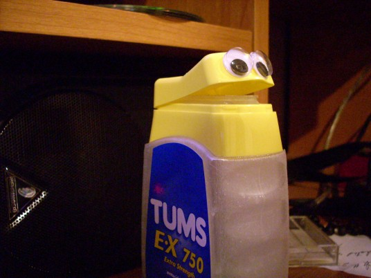 a container of tums with googly eyes on it